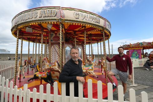 Trevor Cullen and his son Tim of 'Vintage Carousel Company' at their attractions in Dun Laoghaire.  Photograph: Nick Bradshaw/The Irish Times