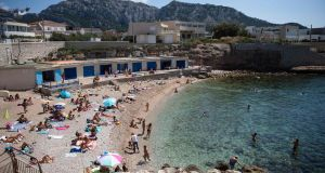 People on  Montredon beach during hot weather in Marseille, southern France, earlier this week. Photograph: Clement Mahoudeau/AFP/Getty