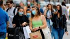 Shoppers wear face masks on Oxford Street in London. Photograph:  Tolga Akmen/AFP via Getty Images
