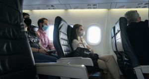 Passengers wearing face masks on an Olympic Air De Havilland Canada aircraft flying from Athens.  Certain  factors on board, such as raised seat backs, can help lessen virus transmission. Photograph:  Nicolas Economou/ NurPhoto via Getty Images