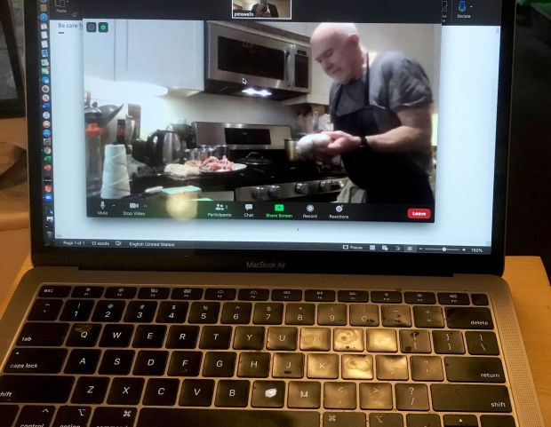 Bill Buford poaching a chicken via Zoom. Photograph: Pete Wells/New York Times