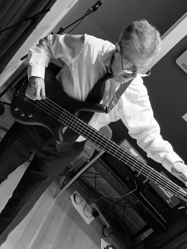 Stephen Travers playing the bass guitar