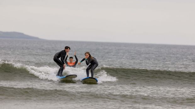 Owen Murphy of Murphs Surf School, giving a surf lesson to Cillian Meehan and Lily Guildfinch, on Tullan Strand, Bundoran, Co. Donegal. Photograph: James Connolly/The Irish Times
