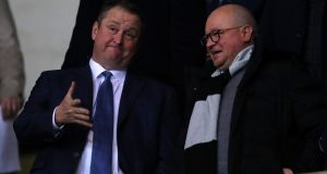 Newcastle United owner Mike Ashley speaks to Lee Charnley. Photo: Catherine Ivill/Getty Images