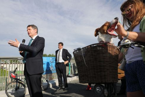 ON YOUR BIKE: Dublin City Council opens phase two of Royal Canal Premium Cycle Route. Minister for Finance Pascal Donohoe addresses the crowd as Minister for Climate Action, Communications Networks and Transport Eamon Ryan and 'Poppy' look on. Photograph: Nick Bradshaw/The Irish Times
