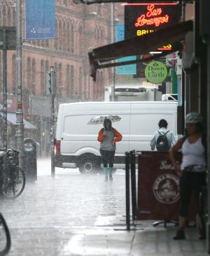 BUCKETING: A heavy rain shower lashes South Great Georges Street in Dublin city centre. Photogrph: Stephen Collins/Collins Photos
