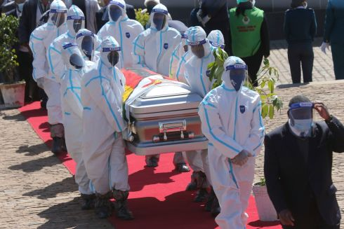 FUNERAL: Health officials carry the coffin of Zimbabwean minister Perence Shiri, who died of Covid-19, during his burial in Harare on Friday. Zimbabwes capital was deserted on Friday, as security agents vigorously enforced the country's lockdown amidst planned protests. Photograph: Tsvangirayi Mukwazhi/AP