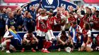 Arsenal players react after Pierre-Emerick Aubameyang drops the trophy. Photograph: PA