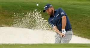 Shane Lowry plays a shot from a bunker on the 16th hole during the third round of the World Golf Championship-FedEx St Jude Invitational at TPC Southwind in Memphis, Tennessee. Photo: Michael Reaves/Getty Images