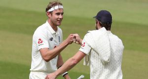 Stuart Broad celebrates England's win over the West Indies in the third Test with team-mate Chris Woakes. Photograph: Martin Rickett/AFP via Getty Images
