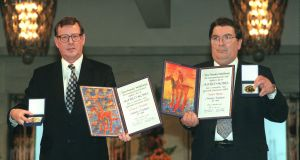 The Nobel Peace Prize winners, First Minister David Trimble and John Hume MEP display the Alfred Nobel medals and diplomas during the presentation ceremony in Oslo City Hall. File Photograph:  Matt Kavanagh.