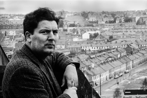 Portrait of Irish politician John Hume as he poses on a rooftop that overlooks the Catholic Bogside neighborhood,  Derry, Northern Ireland, 1970. He went on to win a Nobel Peace Prize for his role in various agreements, including the Good Friday Agreement, during the Northern Ireland peace process. Photograph: Leif Skoogfors/Getty Images
