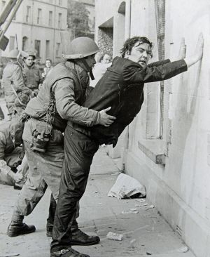 John Hume is detained by soldiers during a civil rights protest in Derry in August 1971. Photograph: Willie Carson