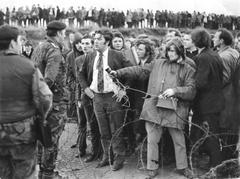 Magilligan Anti-Internment Rally, Derry 1972. Mr John Hume who participated in the rally,  speaking to a British army soldier.  Photograph: Jimmy McCormack / The Irish Times