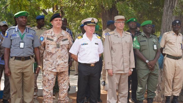 Chris Reynolds (centre) at a meeting in Mogadishu with various officials in January of this year.