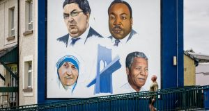 HUME MEMORIAL: A man walks past the Bogside mural in Derry city of John Hume, Martin Luther King jnr, Mother Teresa, and Nelson Mandela, after John Hume's death. Photograph: Liam McBurney/PA Wire