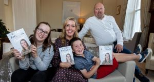Vicky Phelan with her family, Amelia, Darragh and Jim, at the launch of her book Overcoming, at the University of Limerick. Photograph: Alan Place