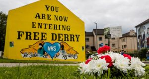 Flowers and a message to the late John Hume rest below a Free Derry Corner in the Bogside of Derry City. Photograph: Liam McBurney/PA Wire.