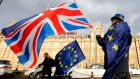 An anti-Brexit demonstrator waves a Union flag alongside an EU flag outside the Houses of Parliament in London in 2018. Photograph: Tolga Akmen/AFP/Getty Images