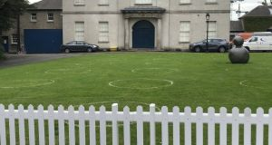 The socially distanced patches of grass within which you are encouraged to enjoy your coffee and muffins at the Royal Hospital Kilmainham are marked with white circles, which adds to the sense of oddness.