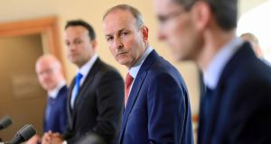 Minister for Health Stephen Donnelly, Tánaiste Leo Varadkar, Taoiseach Micheal Martin and Dr Ronan Glynn during the post-Cabinet press briefing. Photograph: Julien Behal Photography/PA Wire