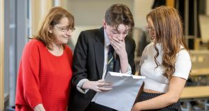 Dylan Quigley finding out his exam results with his sister Louise and mum Susan at Linwood High in Renfrewshire. Photograph: Jeff Holmes/JSHPIX/PA Wire