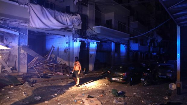 A man walks in the partially destroyed neighbourhood of Mar Mikhael. Photograph: Patrick Baz/AFP via Getty Images