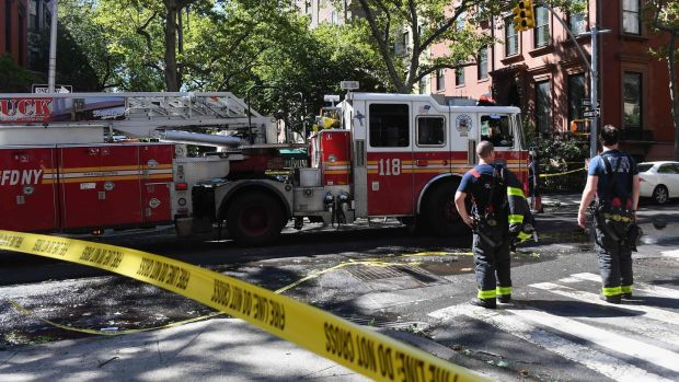 Fire fighters respond to a call in Brooklyn Heights after Isaias approached New York City on August 4th, 2020. Photograph: Angela Weiss/AFP via Getty Images