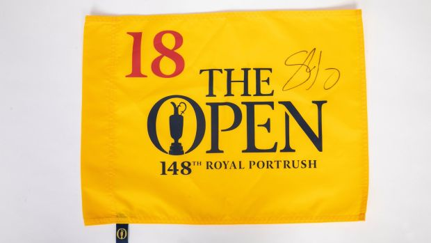 Celebrity Charity: Shane Lowry's memento flag from the 18th gap at Royal Portrush, signed by the Start Championship winner.Photo: SON Photographic Ltd T/A Coalesce/PA Wire