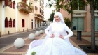 Beirut bride poses for pictures as explosion hits