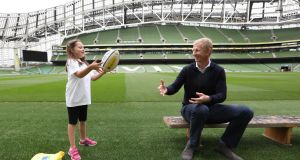Leinster coach and AsIAm ambassador  Leo Cullen  with six-year-old Catalina Ryan from Terenure at the Aviva stadium. Photograph:  Sasko Lazarov/Photocall Ireland
