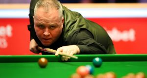 John Higgins made his maiden Crucible 147 on Thursday. Photograph: Alex Pantling/Getty