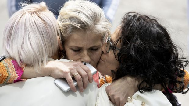 Mary Moran, centre, is hugged by her sisters Bridget O'Reilly and Anne O'Reilly. Photograph: Tom Honan