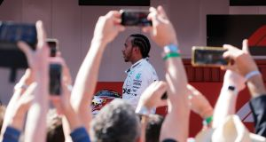Formula One racing driver Lewis Hamilton shared a post on social media insinuating the Covid-19 pandemic was a ruse by Bill Gates to microchip people. Photograph: Jon Nazca/Reuters