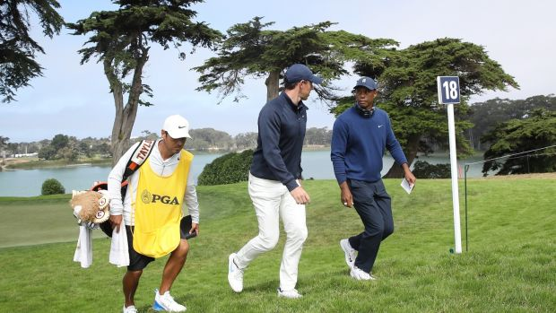 McIlroy and Woods chat while walking to the 18th tee. Photo: Sean M. Haffey/Getty Images
