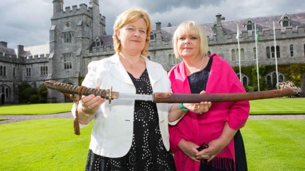 Daughters of the late Dr Aidan MacCarthy from Castletownbere, Co Cork. Nicola and Adrienne MacCarthy, with the sword presented to Dr Aidan by Japanese 2nd Lieutenant Isao Kusuno at the premier of 'A Doctors Sword' in UCC. Photograph: Darragh Kane