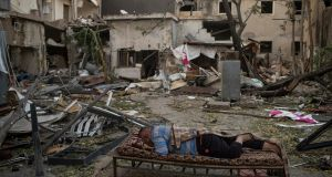 A man sleeps outside in the devastated Karantina district near the port in Beirut last week. Photograph: Diego Ibarra Sanchez/The New York Times