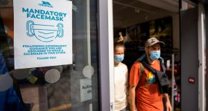 Sign advising customers at Trespass store in Belfast that the wearing of face masks is mandatory. Photograph: Liam McBurney/PA Wire
