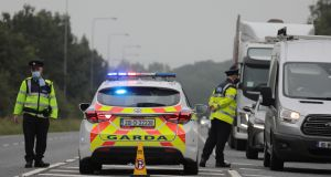 Garda checkpoint between the Meath and Kildare border near the N4 motorway at Kilcock, Co Kildare, on Monday. A spike in coronavirus cases has forced the reintroduction of local restrictions in Kildare, Laois and Offaly. Photograph: Collins Photos