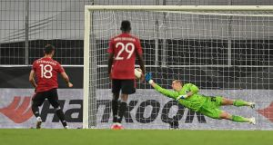 Manchester United's Bruno Fernandes scores a penalty during the Europa League quarter-final win over Copenhagen at the RheinEnergieStadion stadium in Cologne. Photo: Sascha Steinbach/POOL/AFP via Getty Images