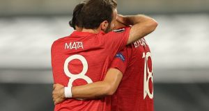 Manchester United players Bruno Fernandes and Juan Mata after their team's extra-time win over FC Copenhagen in Cologne. Photograph: EPA