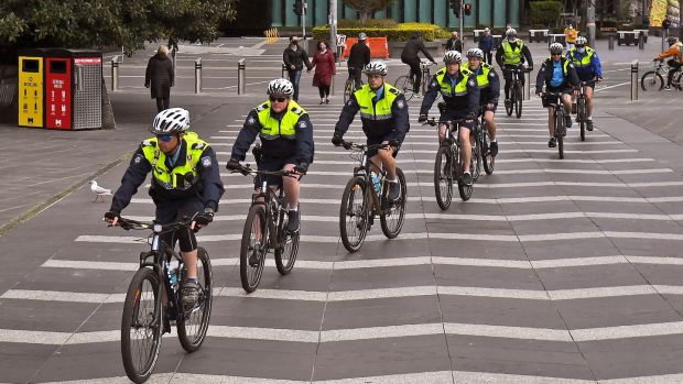 Police officers ride their bikes through the Southbank district of Melbourne on August 12th, 2020. Photograph: William West/AFP/Getty Images