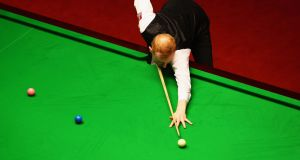 Anthony McGill of Scotland in action during   the World Snooker Championship.