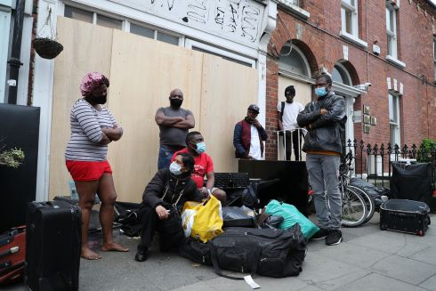 DUBLIN EVICTION: Evicted tenants are pictured with their belongings outside a property on Berkeley Road, Dublin. Photograph: Nick Bradshaw/The Irish Times