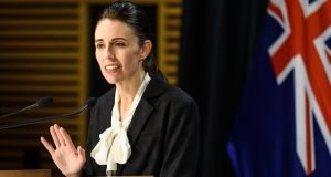 New Zealand prime minister Jacinda Ardern speaks with media in Wellington on Thursday. Photograph: Getty Images