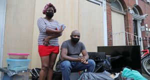 Former occupants Theresa Chimamkpam with Elias Jegede with their belongings after being evicted from  Berkeley Road, Dublin, on Wednesday. Photograph: Nick Bradshaw