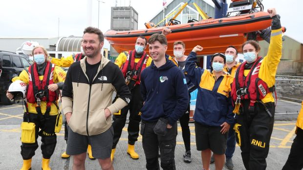 Patrick Oliver and his son Morgan, who rescued the two women off Inis Oirr island, with some of Patrick's RNLI colleagues on their arrival back at the Galway RNLI Lifeboat Station at Galway Docks. Photograph: Joe O'Shaughnessy
