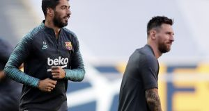 Luis Suarez and Lionel Messi train in Lisbon ahead of tonight's clash with Bayern Munich. Photograph: EPA