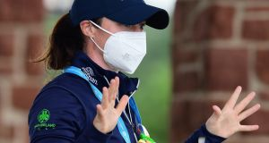 Leona Maguire arrives at the course wearing a protective face covering during day two of the Aberdeen Standard Investments Ladies Scottish Open at The Renaissance Club in North Berwick, Scotland. Photo: Mark Runnacles/Getty Images