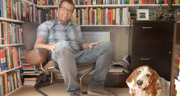 Paul Howard with his dog, Humphrey, at home in Co Wicklow. Photograph: Dara Mac Dónaill / The Irish Times